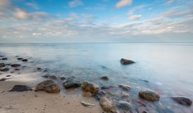 Beautiful long exposure landscape of rocky sea shore Stock Photo