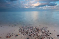 Beautiful long exposure landscape of rocky sea shore Stock Photos