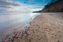Beautiful long exposure landscape of rocky sea shore Stock Photography