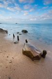 Beautiful long exposure landscape of rocky sea shore. Stock Images