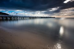 Beautiful long exposure seascape with wooden pier Stock Images
