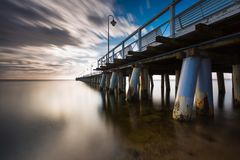 Beautiful long exposure seascape with wooden pier Stock Photos