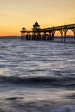 Beautiful long exposure sunset over ocean with pier silhouette. Stunning long exposure sunset over ocean with pier silhouette Royalty Free Stock Photo