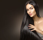 Beautiful long hair. Beauty model girl touching healthy hair royalty free stock image