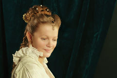 Beautiful long hair blonde girl wearing  nightgown. Combing hair  antique brush in a renaissance style Stock Photo