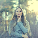 Beautiful long hair blonde woman touching her face. Outdoor fash. Ion portrait Royalty Free Stock Photos