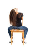 Beautiful long hair brunette siting backwards on the chair Stock Image
