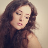 Beautiful long hair brunette woman looking mystery. Color art portrait Stock Photo
