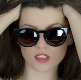 Beautiful long hair brunette woman wearing sunglasses portrait, Stock Image