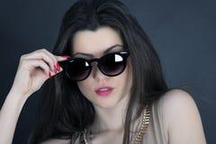 Beautiful long hair brunette woman wearing sunglasses portrait, Stock Images