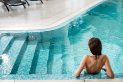 Beautiful long hair female model posing by the pool Royalty Free Stock Image