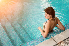 Beautiful long hair female model posing by the pool Royalty Free Stock Photography