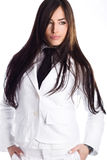 Beautiful long hair woman in white suit Royalty Free Stock Images