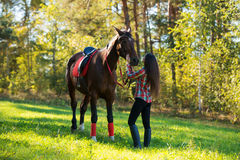 beautiful long hair young woman with horse outdoor Royalty Free Stock Images