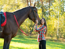 Beautiful long hair young woman with horse Stock Photo