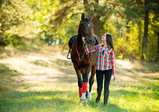 Beautiful long hair young woman with a horse Royalty Free Stock Photography