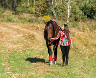 Beautiful long hair young woman with horse Stock Image