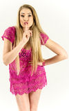 Beautiful long-haired blonde in a pink dress standing lush, flirty skirt lifting Royalty Free Stock Photo