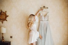 Beautiful long haired blondie bride with wedding dress. stock images