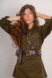 Beautiful long-haired girl in military style Royalty Free Stock Photos