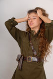 Beautiful long-haired girl in military style Royalty Free Stock Images