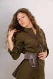 Beautiful long-haired girl in military style Stock Images