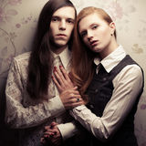 Beautiful long haired people in vintage style Royalty Free Stock Photos