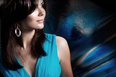 Beautiful long-haired woman in a blue dress on Stock Photos