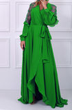 Beautiful long haired woman in green dress Stock Photography
