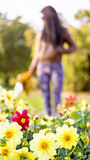 Beautiful long haired woman and many flowers Royalty Free Stock Image