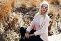 Beautiful long-haired woman in sunglasses Royalty Free Stock Photos