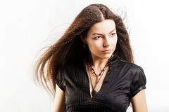 Beautiful long-haired young woman has a dream royalty free stock photography