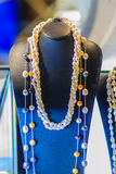 Beautiful long pearl necklaces are displayed at a jewelry shop. Royalty Free Stock Image