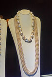 Beautiful long pearl necklaces are displayed at a jewelry shop. Stock Images