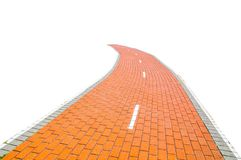 Red brick road isolated on white background. royalty free stock image
