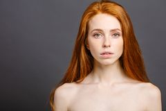 Long red health hair of young attractive woman. Beautiful long red health hair of young attractive woman Stock Image
