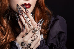 Beautiful long sharp black graft acrylic nails image for witches Stock Photo
