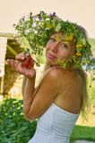 Beautiful long-white hair woman in white dress and flower wreath keep in hand bunch of red currant berries. Summer day, hot and stock photos