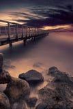 Beautiful long wooden jetty at beach Stock Image