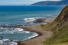 Beautiful Lost Coast beach and hills in shadow extend invitation to visit to viewer Stock Image