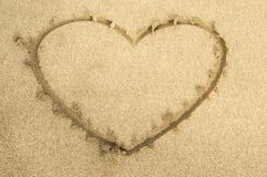 Love heart drawing on beach sand. Beautiful love heart top drawing on sand beach seaside tropical feeling royalty free stock photo