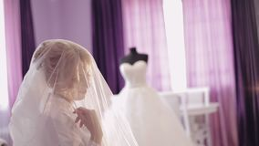 Beautiful and lovely bride in night gown. Pretty and well-groomed woman. Wedding morning. Slow motion stock video footage