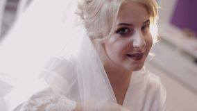 Beautiful and lovely bride in night gown. Pretty and well-groomed woman. Wedding morning. Slow motion.  stock video