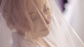 Beautiful and lovely bride in night gown. Pretty and well-groomed woman. Wedding morning. Slow motion.  stock footage