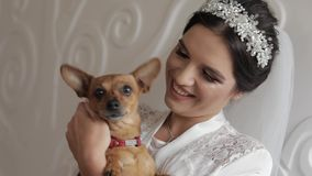 Beautiful and lovely bride in night gown and veil with funny dog. Wedding. Beautiful and lovely bride in night gown and veil with funny dog. Pretty and well stock footage