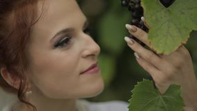 Beautiful and lovely bride in night gown and veil in the garden. Wedding morning. Beautiful and lovely bride in night gown and veil in the grape garden. Pretty stock video footage