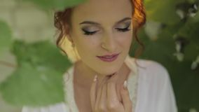 Beautiful and lovely bride in night gown and veil in the garden. Wedding morning. Beautiful and lovely bride in night gown and veil in the grape garden. Pretty stock video