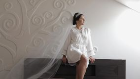 Beautiful and lovely bride in night gown and veil. Wedding morning. Slow motion. Beautiful and lovely bride in night gown and veil. Pretty and well-groomed woman stock video