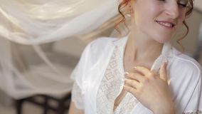 Beautiful and lovely bride in night gown and veil. Wedding morning. Slow motion. Beautiful and lovely bride in night gown and veil. Pretty and well-groomed woman stock footage