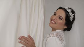 Beautiful and lovely bride in night gown and veil. Wedding dress. Slow motion. Beautiful and lovely bride in night gown and veil near wedding dress. Pretty and stock footage